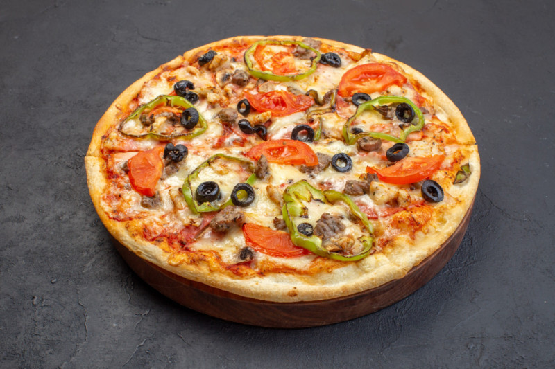 front-view-delicious-cheese-pizza-consists-olives-pepper-tomatoes-dark-surface